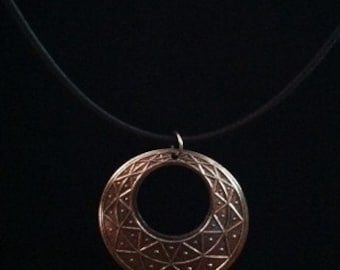 Silver filigree pendant on cotton necklace base