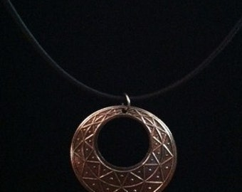 Silver filigree pendant on cotton necklace base