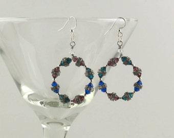 Rainbow Swarovski crystal and antiqued cut silver chandelier earrings.