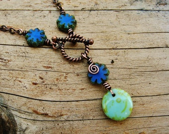 Wire Wrapped Lariat necklace of Antiqued Copper and Periwinkle Blue Czech Picasso glass flower beads and Aqua Picasso dangle