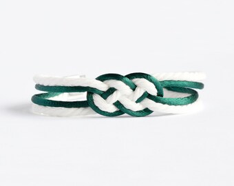 Dark emerald green and matte white double infinity knot nautical rope bracelet with your choice of silver anchor, heart or ship wheel charm
