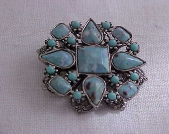 Turquoise colored plastic stone 1960's brooch