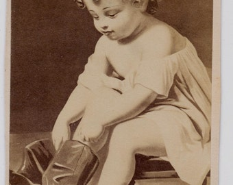 1860s - 1870s Antique CDV. Child Putting on Boots