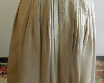 """1950's, 28"""" waist, ecru and gold embossed pleated skirt."""