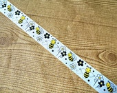 1.5 inch wide Buzzing Bee printed Ribbon, black & yellow bumble bees with flowers on a white grosgrain ribbon, DIY party crafting supplies