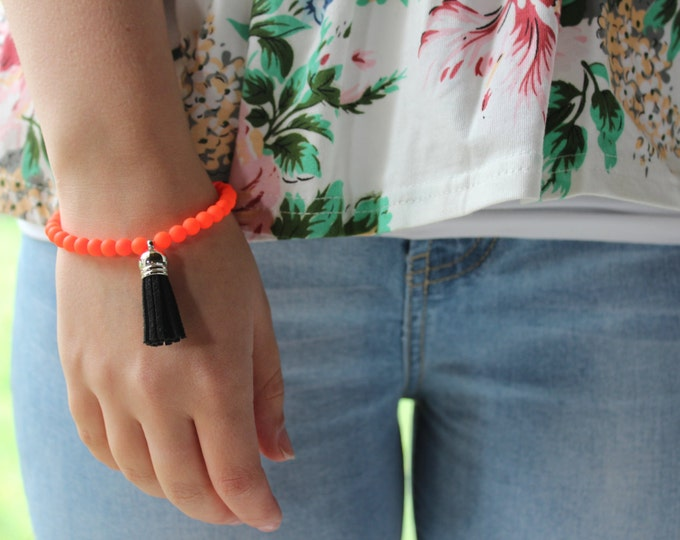 Neon Orange and Black Tassel Bracelet.