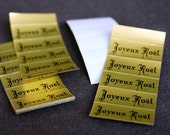 Joyeux Noel. Vintage French Merry Christmas golden stickers. Retro gift tags.