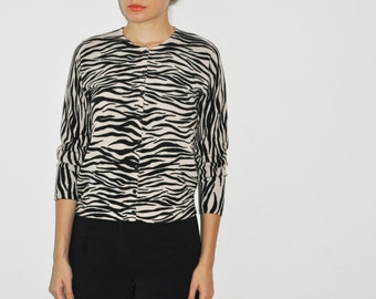 vintage black and ivory zebra print button-up cardigan with three-quarter sleeves, round neck, and small black buttons