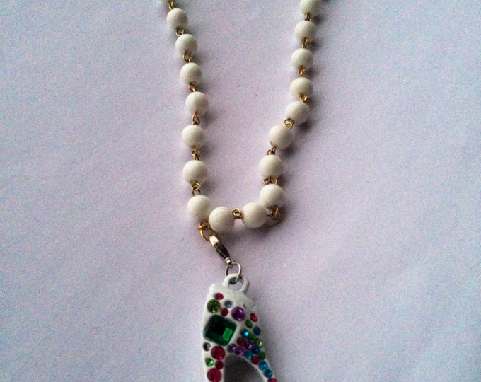 Jewelry Necklace Ladies High Heel Shoe Necklace on a White Faux Pearl chain