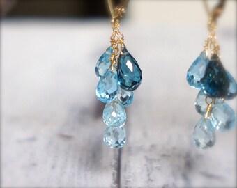 Blue topaz earrings. 18K solid gold gold london blue topaz & swiss blue topaz briolette earrings.  Blue gemstone ombre cascade earrings.