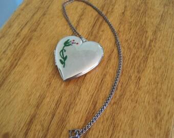 Vintage heart locket necklace.  Rhinestone accent.  Silvertone.