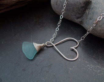 Sea glass jewelry, Beautiful blue sea glass dangles from sterling silver heart