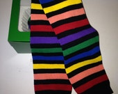 Rainbow Black Striped Leg Warmers Packaged like a Cupcake
