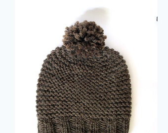 Brown knit pom pom hat