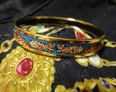 MINT. Vintage Hermes cloisonne enamel golden bangle with leopard and blue design. Made in Austria. Great gift idea