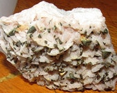 Marcasite Crystals on Pale Pink Saddle-Shaped Dolomite with Calcite from Missouri.