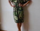 Dress in jungle print , midi length . Green, black, gold. Graphic. Gatsby kimono sleeves. One size fits many.