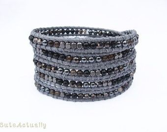 Black wrap bracelet with hematite, stone, crystal, metal beads on gray polyester cord