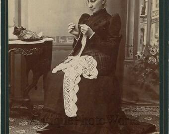 Woman crocheting lace antique art cabinet photo