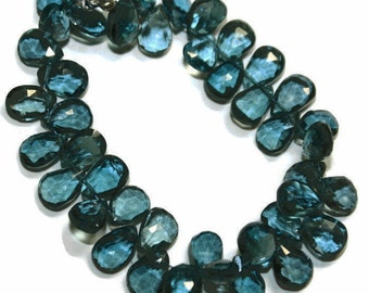 London blue topaz faceted briolettes.  Approx. 5-5.5x9.25mm   Select a quantity.
