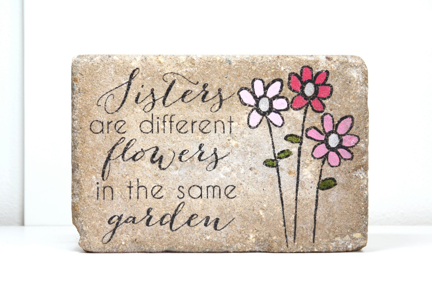 Garden Stone Sisters Are Different Flowers In The Same