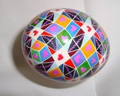 Modern Pysanky Chicken Eggs in geometric shapes with hearts in many colors