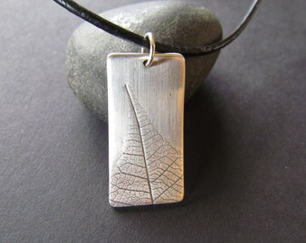 Silver ingot with oxidised leaf imprint
