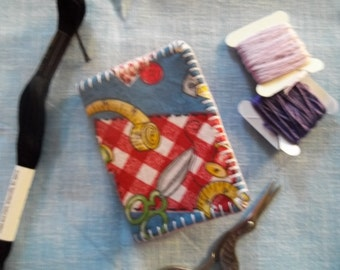 Needle book made with sewing fabric.