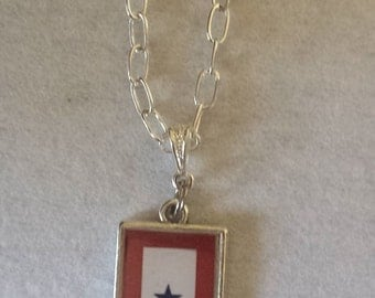 Antique silvertone Blue Star Mother Resin Pendant.
