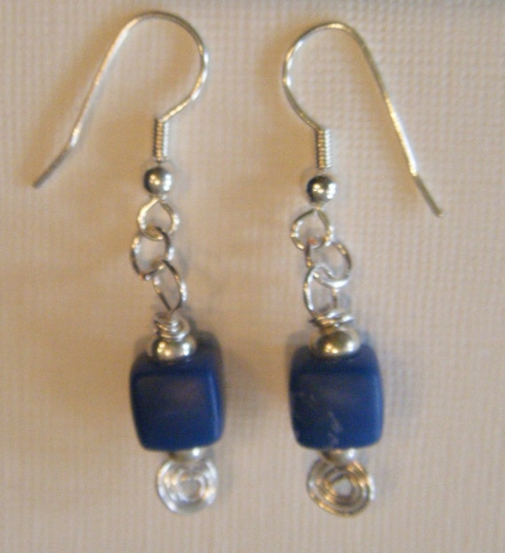 Blue square bead and silver earrings.