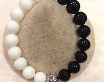 "Genuine  Onyx ""Yin Yang"" stretch bracelet with rhodium plated details"