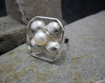 """""""Flower"""" in sterling silver with Cultured Pearl ring."""