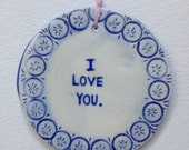 Valentine's I love you ornament in blue and clear glaze earthenware hanging circle