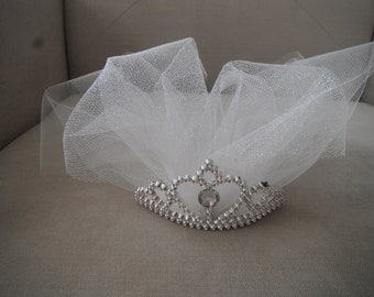 Fun little tiara with tulle for your Bachelorette party!  Goes perfect with your naughty corsage!