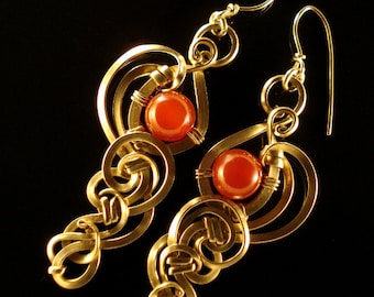 Long, half-round alpacca wire earrings  adorned with carnelian