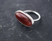 Oval Agate red eye silver ring