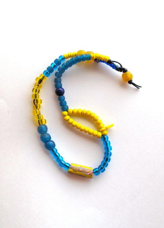 Beaded asymmetrical necklace Native American blue and yellow glass beads African beads on black leather cord