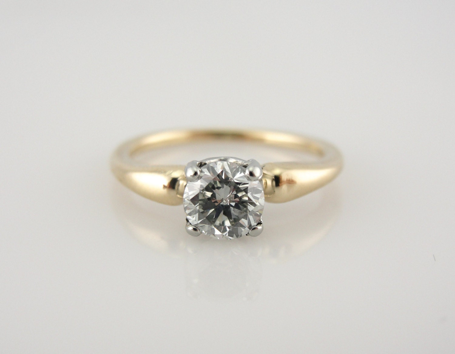 simple low set retro era engagement ring with pretty