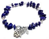 Blue lapis and hamsa throat chakra Unisex charm bracelet with swarovski detail