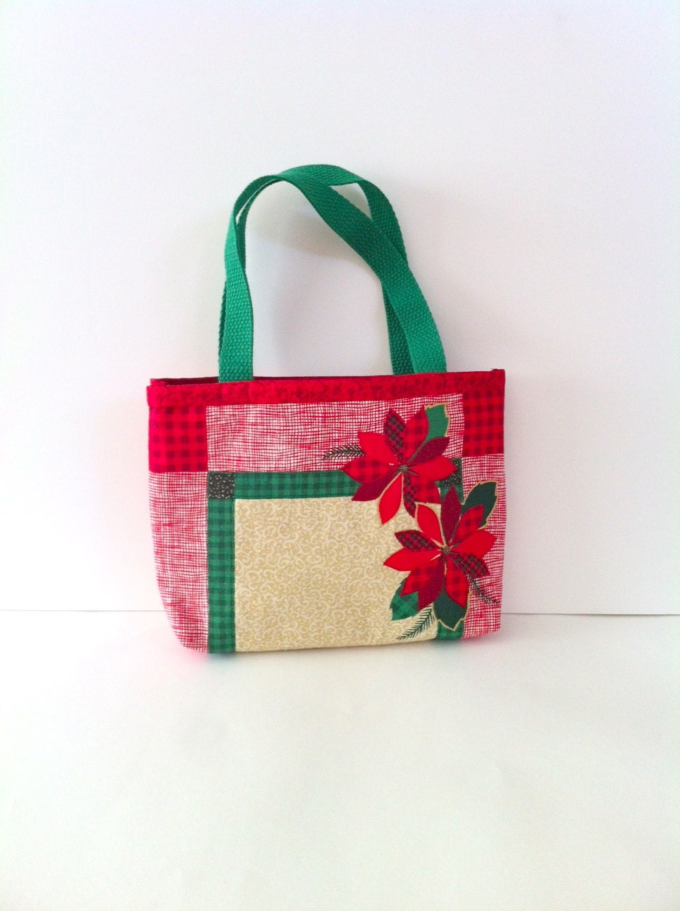 Red holiday tote bag with poinsettias shopping