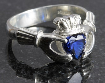 Sterling silver claddagh ring with a heart shape sapphire