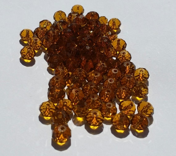 Glass Beads 42 Pcs 8mm X 6mm Dark Amber Faceted