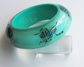 Light blue lucite bracelet with real exotic beetles