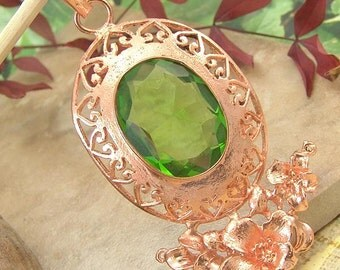 Sale: Faceted Green Glass and Copper Hibiscus Pendant