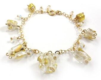 SariGlassman - Lampwork Jewelry from the broken glass from a Jewish Wedding - 22k gold SRA