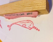 Narwhal rubber stamp mounted on wood