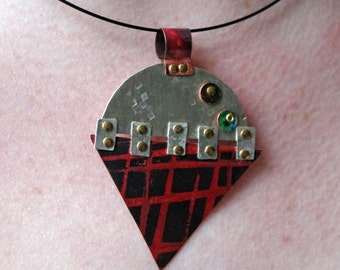 Copper and silver pendant