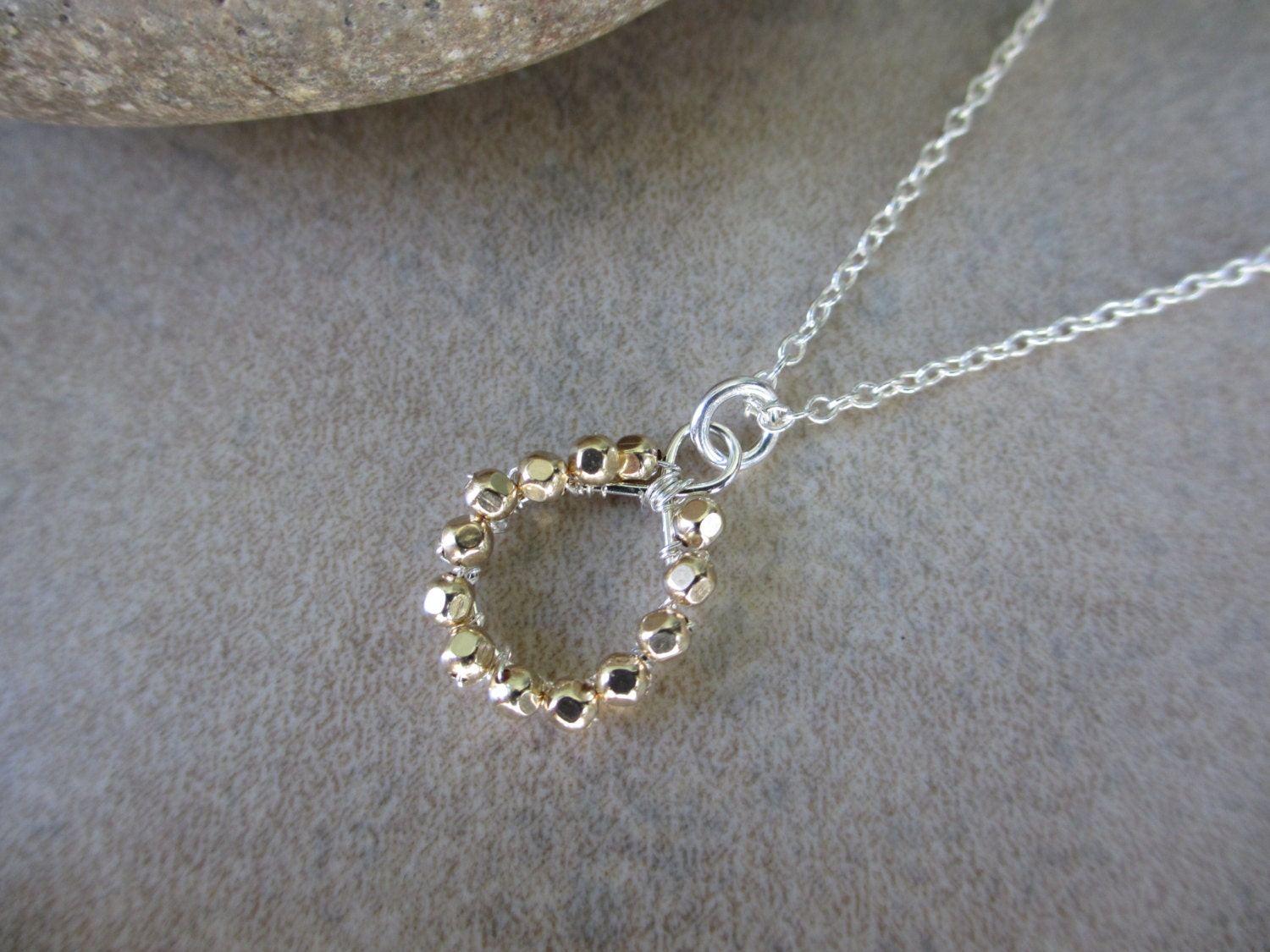 gold and silver necklace circle pendant mixed metals gold