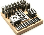 Dapping Jumbo Tool 40 Piece Set With Blocks and Punches on a Wood Stand