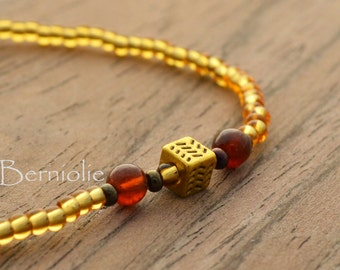 Beaded bracelet, gold glass beads, one gold tibetan style bead, 2 hessonite gem beads, stretchy, 7 inch, S50